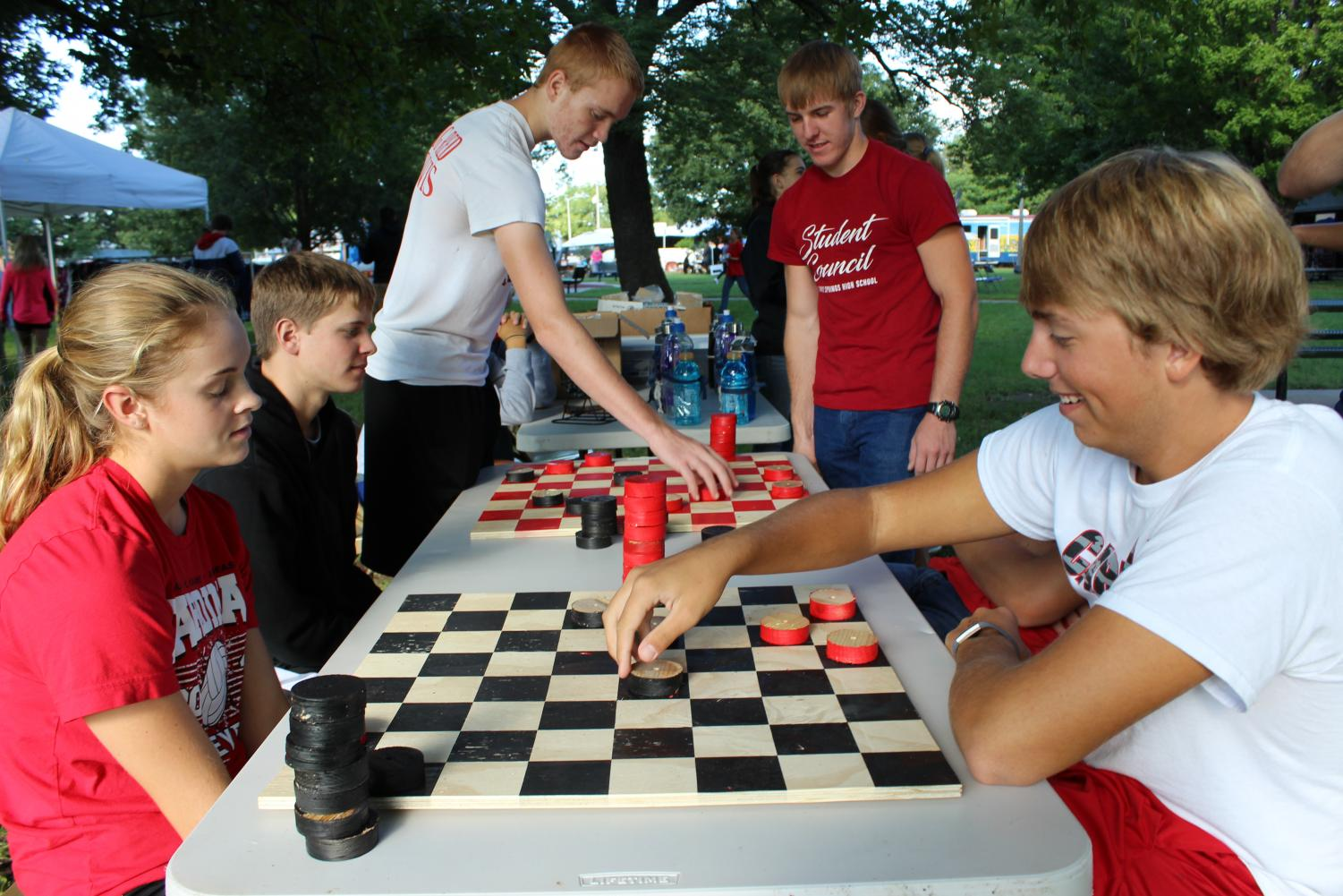 Seniors Makenzie Curry and Nathan Ohl play checkers after the Stand Down was over.