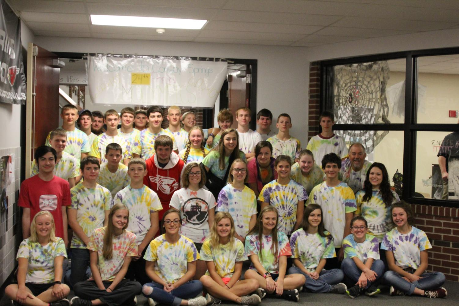 Both Chemistry classes gather together under the Molympics sign for a group photo.