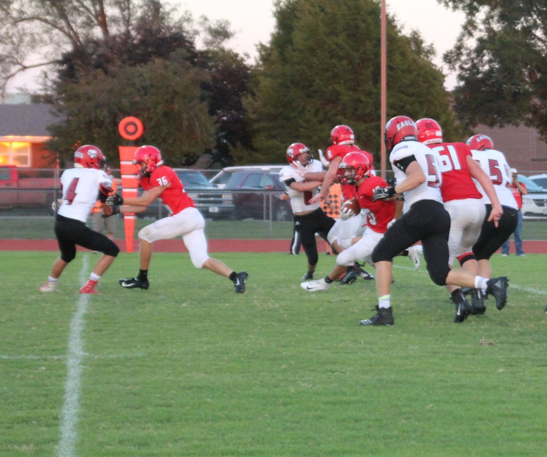 Senior Zach Mercer runs the ball and gets through the Eagles defense
