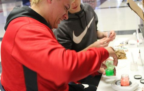 """Seniors Brenden May and Chase Ast make candles for their Genius Hour project. The two chose the scent """"Jamaican Me Crazy."""""""