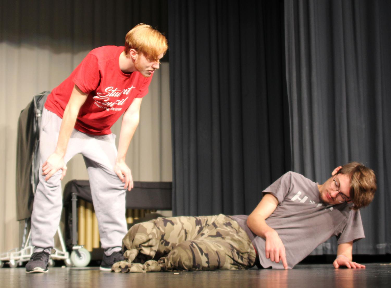 During play practice, Jimmy (senior Caden Runnalls) and Sam (senior Ben Doffing) have a discussion about whether or not to leave legless Doffing behind to sacrifice himself to the zombies so the others can escape.