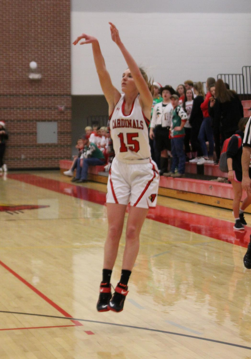 During the Chaparral basketball game Dec. 18, junior Kara Koester shoots a 3-pointer. The girls also had a high scoring game that game, which helped set Christmas break off with a positive start.