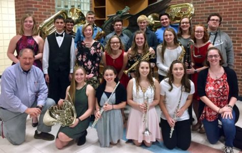 After a long day of practice, honor band and choir participants pose for a photo. The students spent time practicing from 9 a.m. until the performance at 4 p.m. Courtesy photo by Kristy Martin