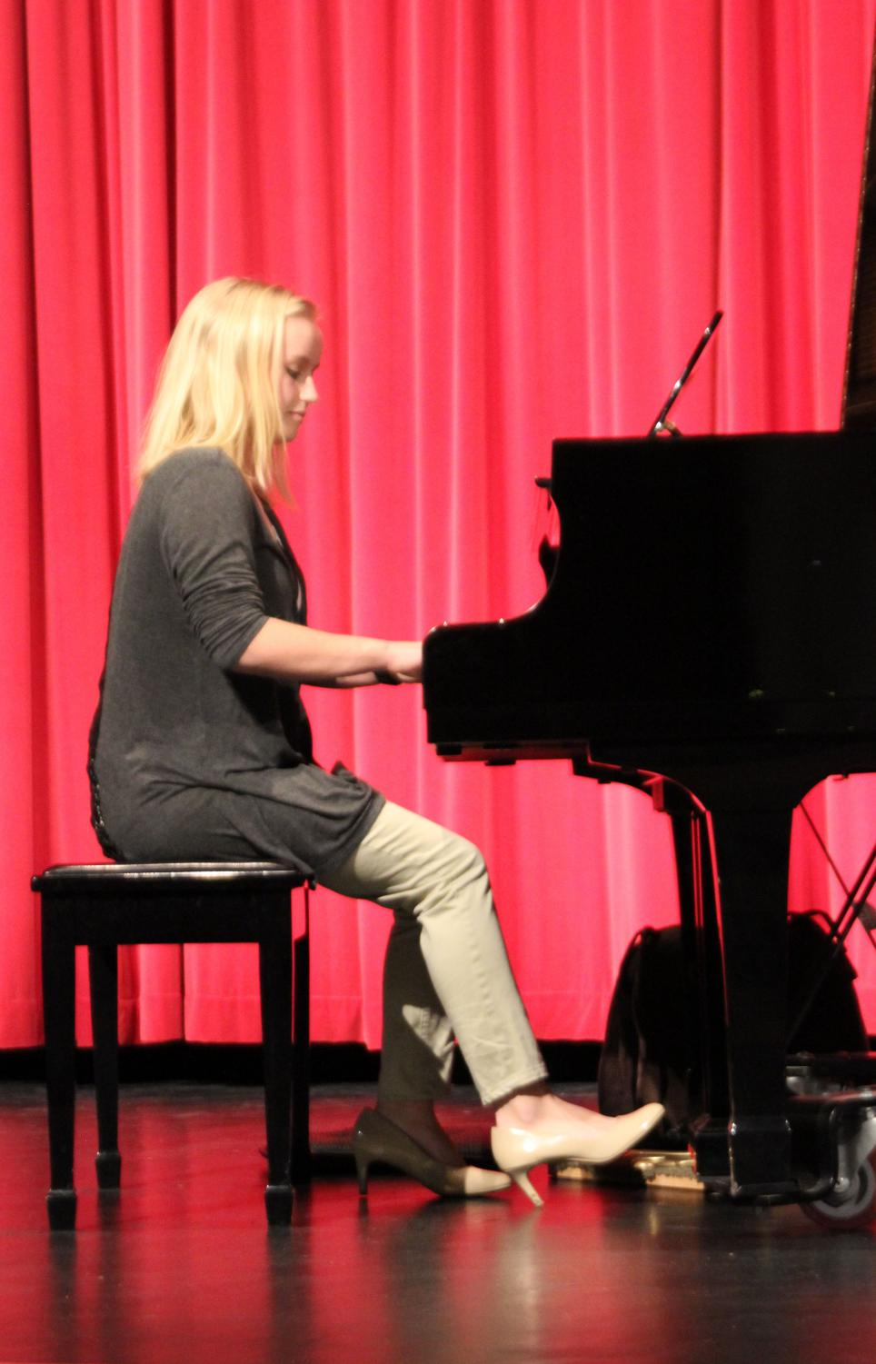 "At the 2019 piano festival, junior Amy Zoglmann performs ""Sonata in D major"" by Hayden for a judge. Zoglmann's rating was a I."