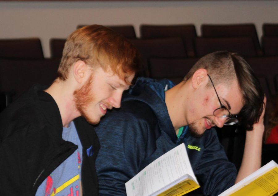 In the auditorium, seniors Ben Doffing and Caden Runnalls read through their parts with the rest of the group for the first time. The cast for the spring play began practice last Thursday.