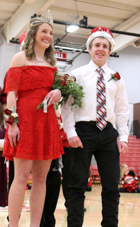 After the results were announced, candidates Koester and Boyles pose for pictures. The ceremony announcing these winners was held after the boys game on Feb. 1.