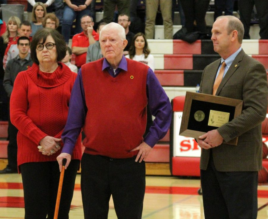 Between+the+girls+and+boys+varsity+game+against+Douglass%2C+Fred+Cottrell+stands+with+his+wife+Janie+as+he+is+awarded+with+the+KSHSAA+Hall+of+Fame.