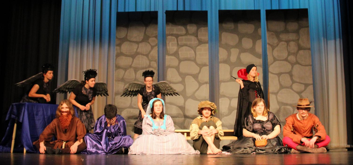 A few days before the first performance, the cast practices at the first dress rehearsal. The evil Sorceress Nefaria, played by junior Amy Zoglmann, has most of the cast imprisoned, with the exception of Tabby, played by senior Makenzie Curry.