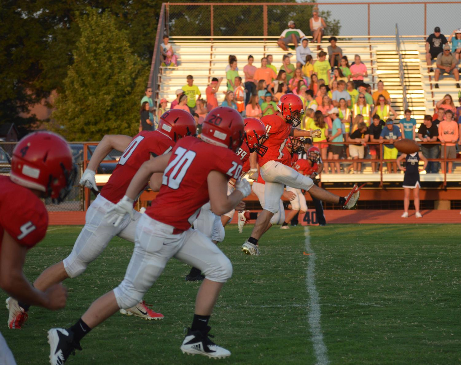 "At the first home game, Cardinals vs the Knights, junior Cole Schulte kicks off the football to start the game. ""I feel this season we will kick more PATs (points after touchdown) and our special teams will be more consistent,"" said junior and varsity kicker Cole Schulte."