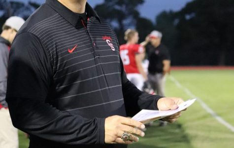 During the game against the Panthers Oct. 4, head coach Matt Biehler observes from the sidelines as the team closes in for a touchdown. This was Biehler's most recent victory after reaching his 100th win as head coach of the Cardinals.
