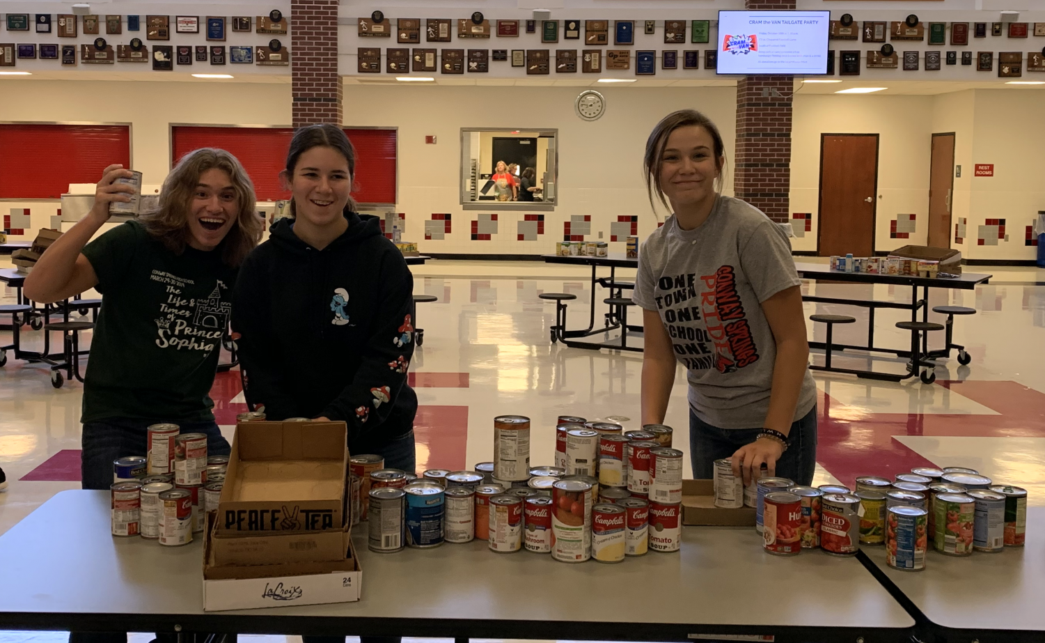 During the Cardinal Care Food Drive, junior Owen Balman and sophomores Averie Stull and Abby Botkin help separate the cans into boxes. Student Council volunteered to co-host the food drive to help donate to families in need.