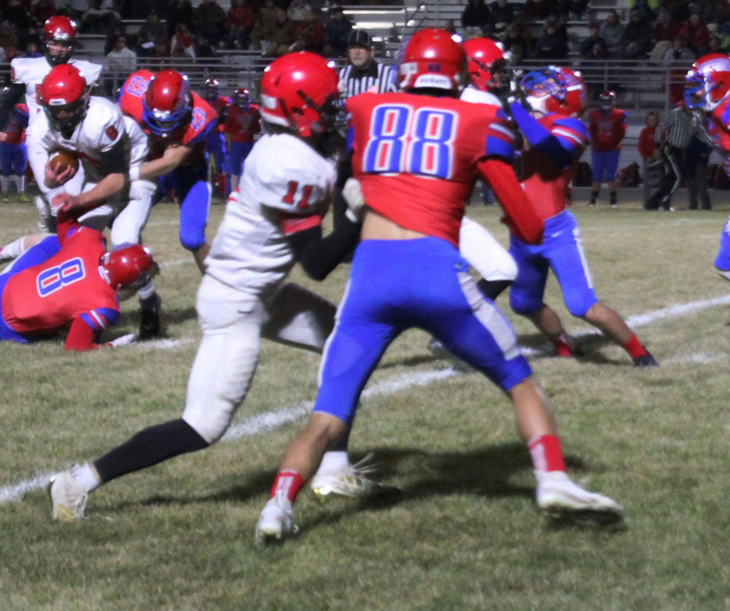 While playing against Eureka, junior Cole Schulte blocks a Tornado. The Cardinals won the game 40-7.
