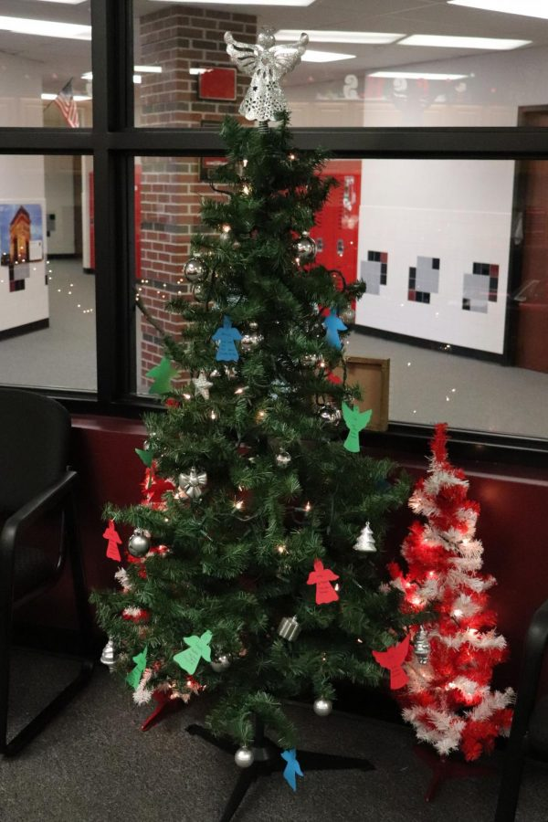 Located in the office, the Angel Tree is decorated with paper angels with lists of gifts for residents at the care home. Honor Society hosted the project, and any student or faculty member was able to participate.