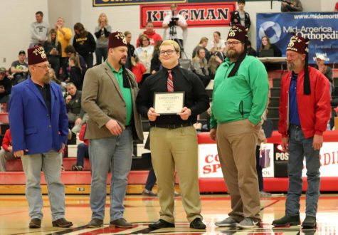 Senior Dawson Martin receives his Shrine Bowl certificate during halftime at the basketball game vs. Garden Plain Jan. 17. Martin will play in the Shrine Bowl on July 18 at Yager Stadium in Topeka.