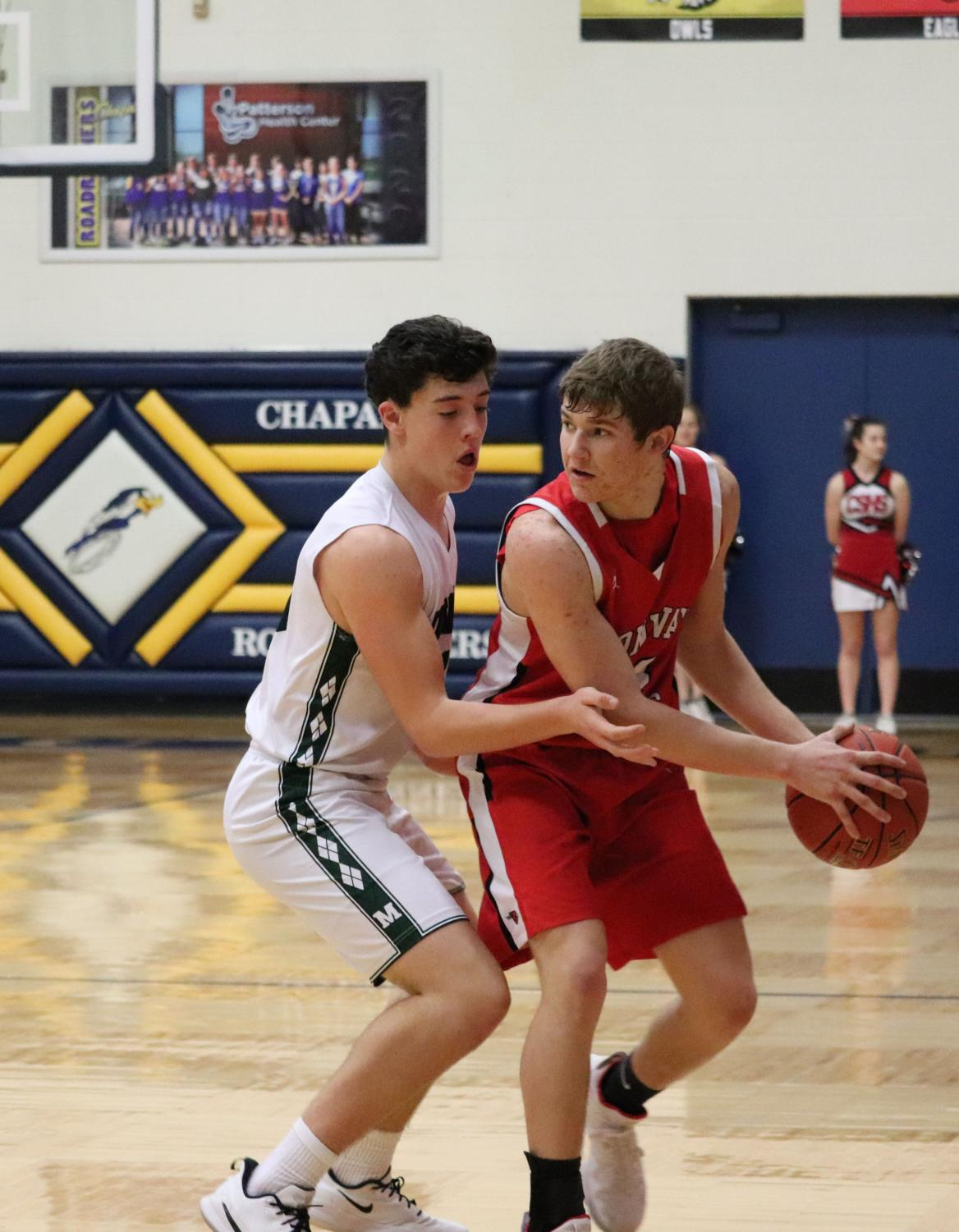 During the final game of the Chaparral tournament, junior Heath Hilger looks for an open player to pass the ball to. The boys placed sixth overall at the tournament after playing Clearwater, Sunrise Academy and Mulvane.