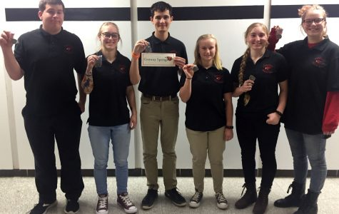 After competing at League, the varsity scholars bowl team poses for a picture with their medals. The team placed third at this meet, before moving on to compete at Regionals. Photo courtesy of Kristy Martin