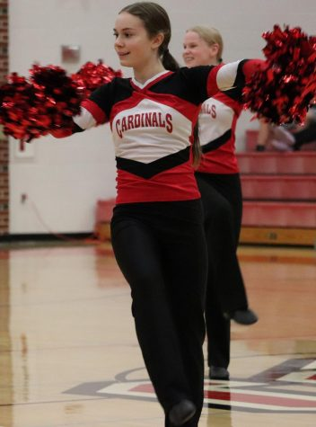 During halftime of the boys basketball game against Douglass, freshman Ava Schulte performs with the dance team. Schulte was one of the returning members of the dance team, along with several others.