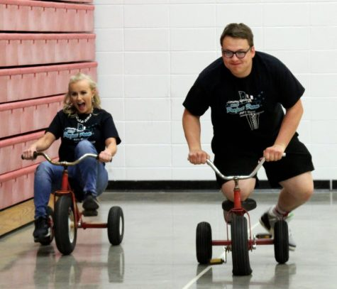 At the 2019 After Prom, juniors Amy Zoglmann and Dawson Martin ride tricycles for a game. Last year's After Prom was held at the high school with various activities put together by the Project Prom committee.