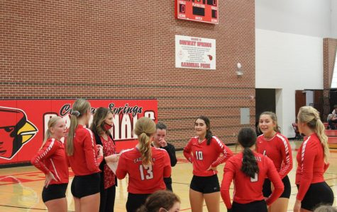 During a timeout, head coach April Zoglmann discusses a game plan for the varsity volleyball team. This took place Sept. 10 when the girls played Halstead.
