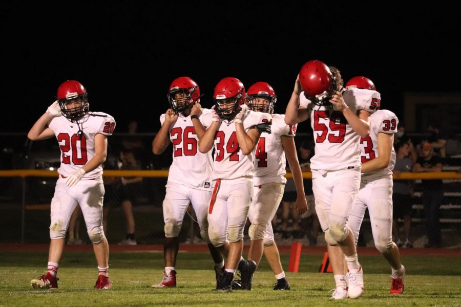 Photo by Cassidy Beal. Football players walk off the field Sept. 4 at Garden Plain High School. Since losing by 1 that day to the Owls, the team has won seven in a row, outscoring their opponents 376-76.