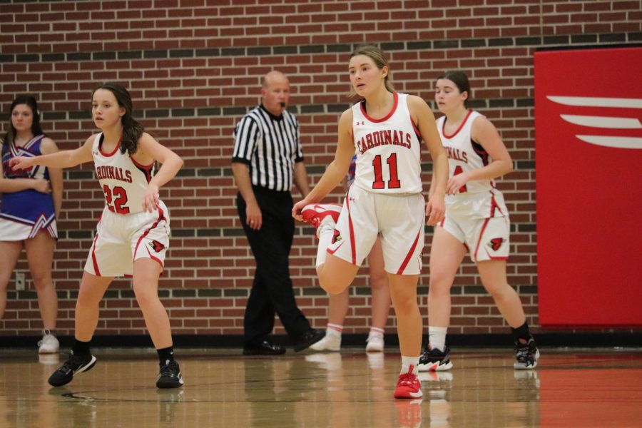 After losing the ball, junior Loren May and freshmen Gabby Dalbom and Haylee Osner prepare to play defense in the varsity girls basketball game against Cheney Dec. 4.