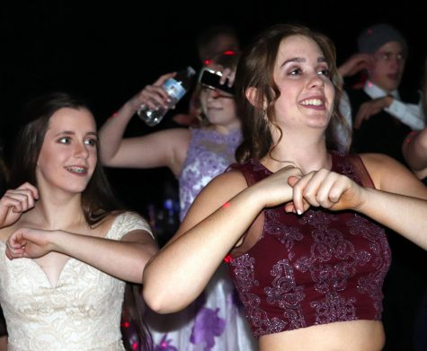 Juniors Lauren Mercer and Emily Heimerman dance at the Winter Formal in 2019. Plans for this year's Winter Formal are still up in the air.