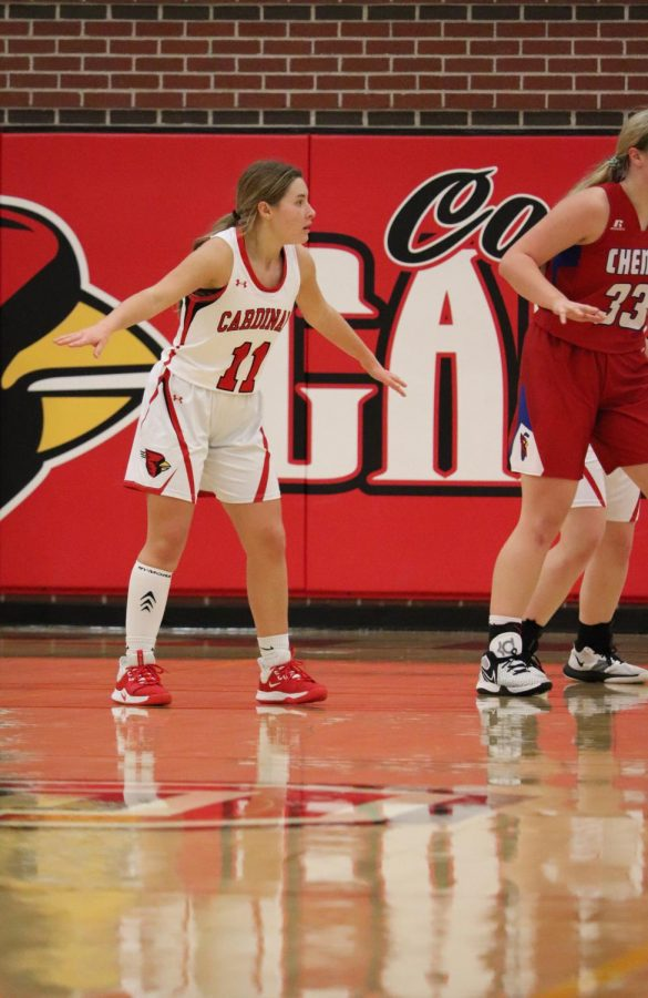 Junior and point guard Loren May guards the paint during a home game against Cheney Dec. 4. May has since suffered an injury to her ACL and meniscus and is out for the rest of the season.