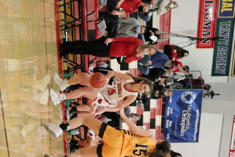 During a game against Garden Plain, freshman Olivia Lange looks for an opening. The girls lost 33-42 to the owls.