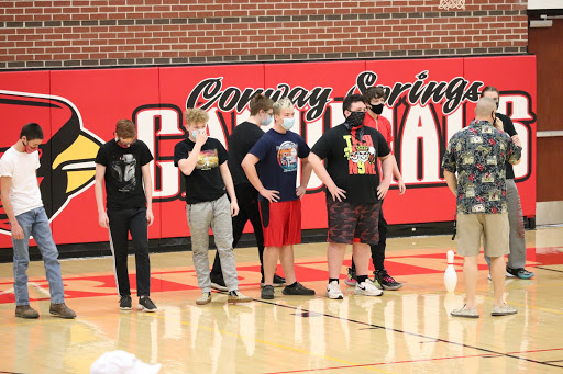 P.E. teacher Matt Biehler tells the sophomore team the rules for Castles as they prepare for the game. The sophomores lost to the seniors in the first round Feb. 2 during activity period. The freshmen also lost to the juniors.