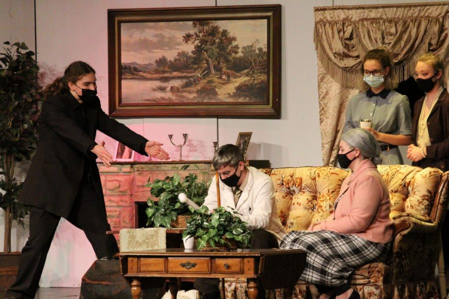 "In the last act of ""The Boardinghouse,"" the characters huddle in the living room as they await an answer to the mystery behind the plot. This was during the Friday night performance on March 26."