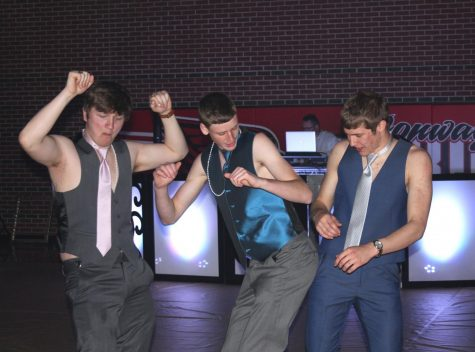 Junior Derek Osner, junior Lance Pauly, and senior Heath Hilger dance during Prom. The dance was from 8:30 to 10 p.m.