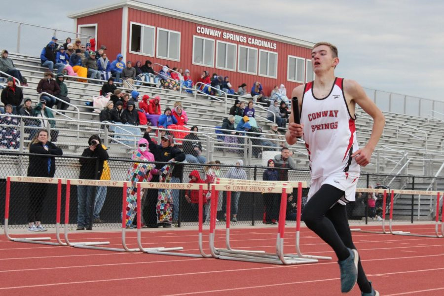 During the 4x800 meter relay, sophomore Zach Johnson sprints his last 100 meters before he hands the baton off to the next runner. This took place at the home track meet April 9.