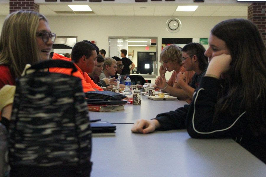 During first lunch, sophomores Faith Kelly and Makenna Smith have a conversation. This school year during lunch, students can sit close to each other and with whomever they want.