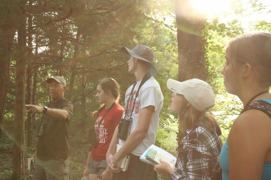 """Students explore the Bartlett Arboretum hunting for various bird species during an all-day birding trip. This was the first trip of the year, in which students identified a total of 40 birds. """"It was fun, and everyone got along pretty well,"""" senior Lance Pauly said."""