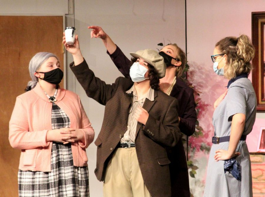 """Last year's senior Brynn Andra, junior Averie Stull, senior Molly Bender, and sophomore Caitlyn May act out in the spring 2021 play """"The Boardinghouse,"""" with 10 cast members. Fall plays are typically shorter and have a smaller cast than the spring plays."""