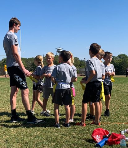 Senior flag football coach Lance Pauly gives his team a talk. Pauly coached the second graders, and their team name was The Sharks.