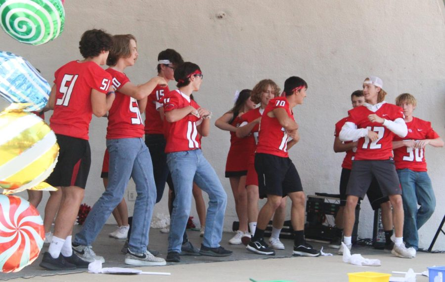 During the Homecoming pep rally, the football boys show off their dance moves with the cheerleaders. This is something new the cheerleaders incorporated into the pep rally.