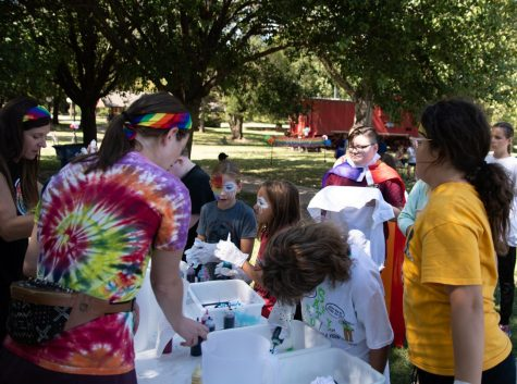 Attendees at the Pride Festival work on colorful tie-dye shirts. The event and all of the activities were sponsored by Conway Loves.